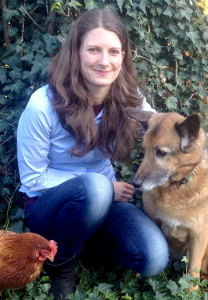 Photo of Dr Marie Dittmann kneeling with pet dog